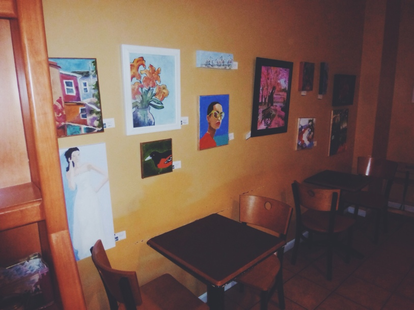 Paintings line the walls of Koba Cafe.